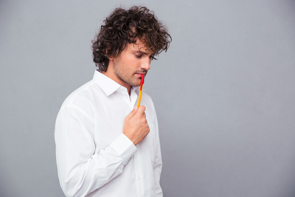 Portrait of a thoughtful businessman with pen