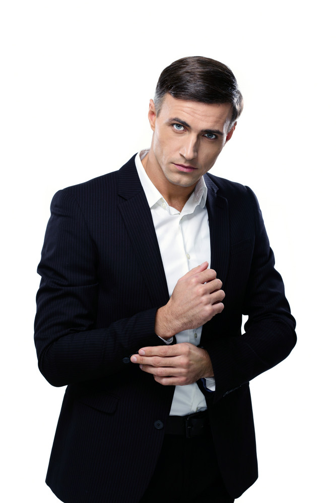Portrait of a young handsome businessman over white background