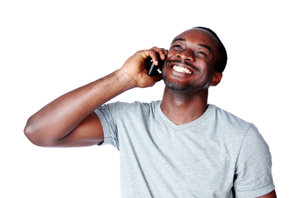 Portrait of african man talking on the phone isolated on a white background