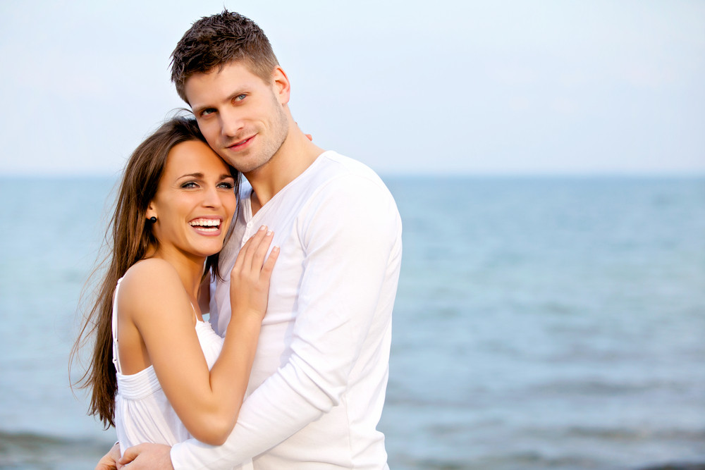 Portrait of an attractive couple enjoying the beach