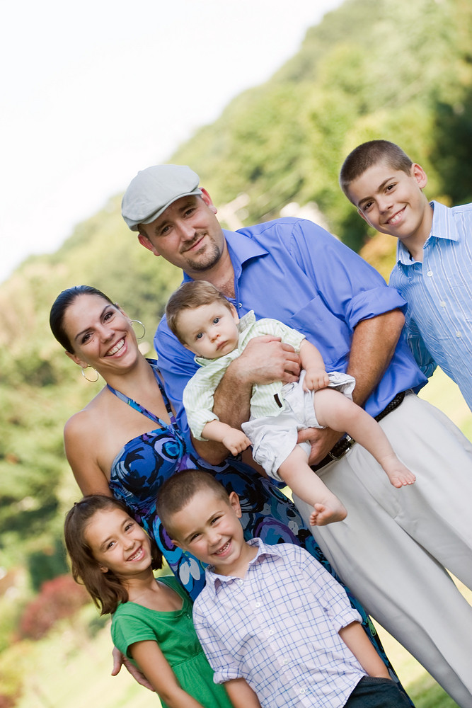Portrait of an nice looking family with four children and one baby.