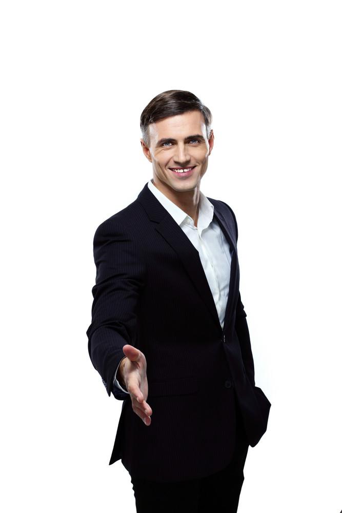 Portrait of businessman handshaking on a white background