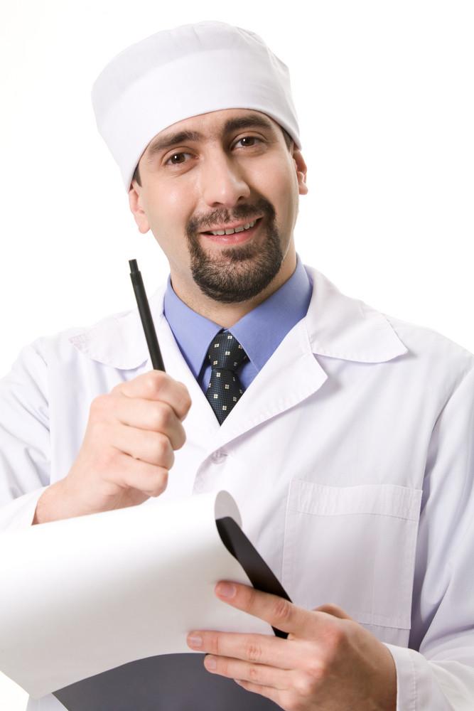 Portrait of confident doctor prescribing medicine and looking at camera