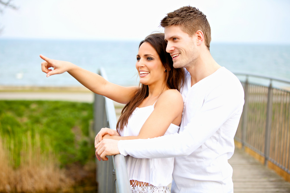 Portrait of smiling young couple enjoying outdoors