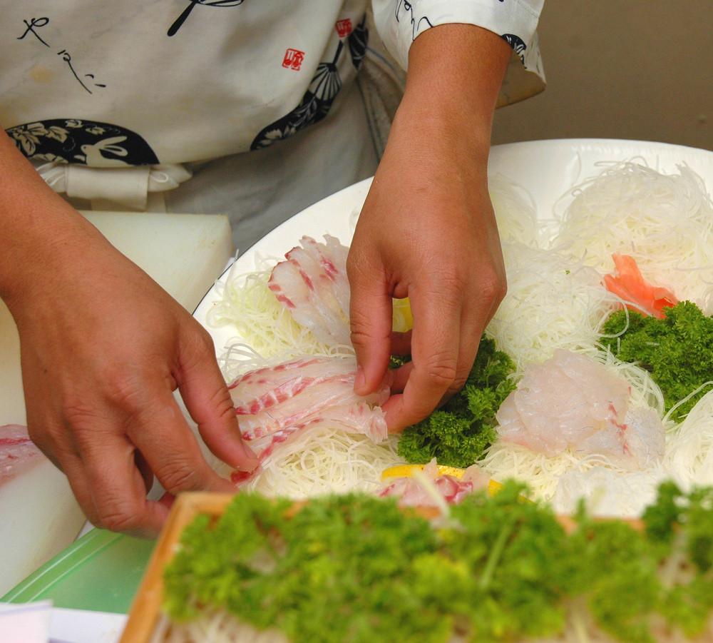 Preparing A Plate Of Sashimi