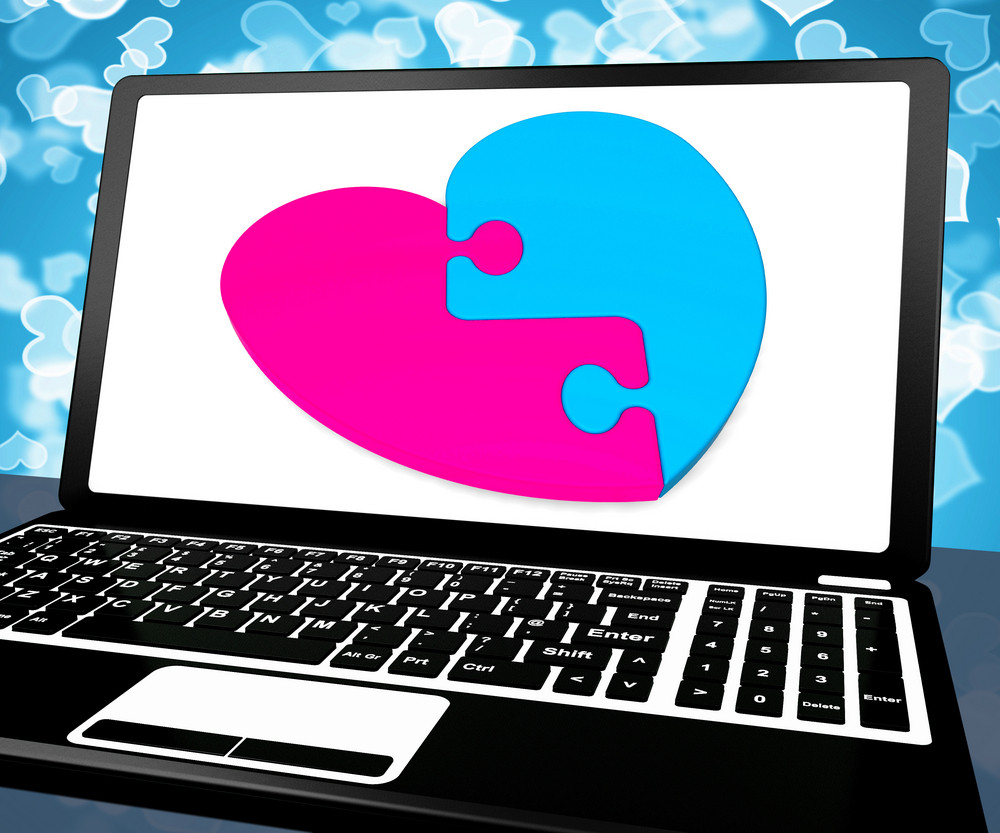 Puzzle Heart On Laptop Showing Online Dating