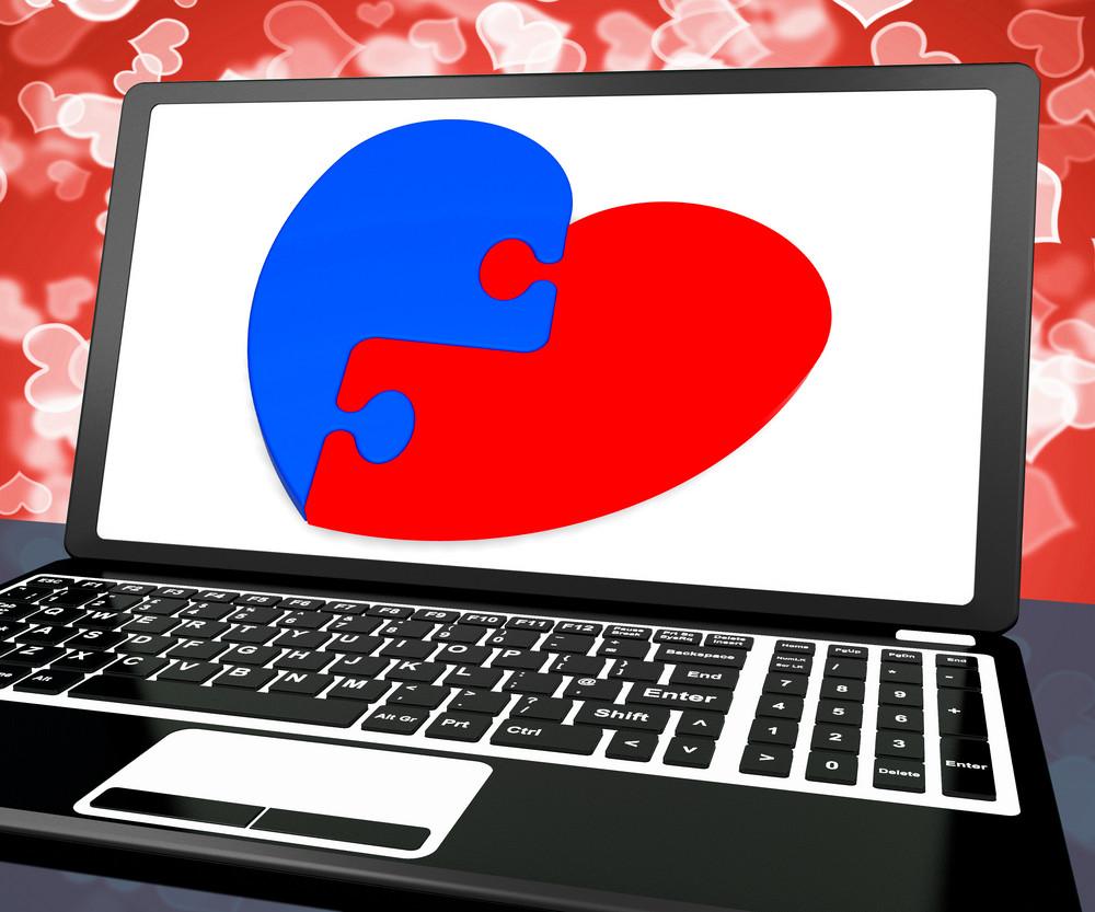 Puzzle Heart On Laptop Shows Engagement