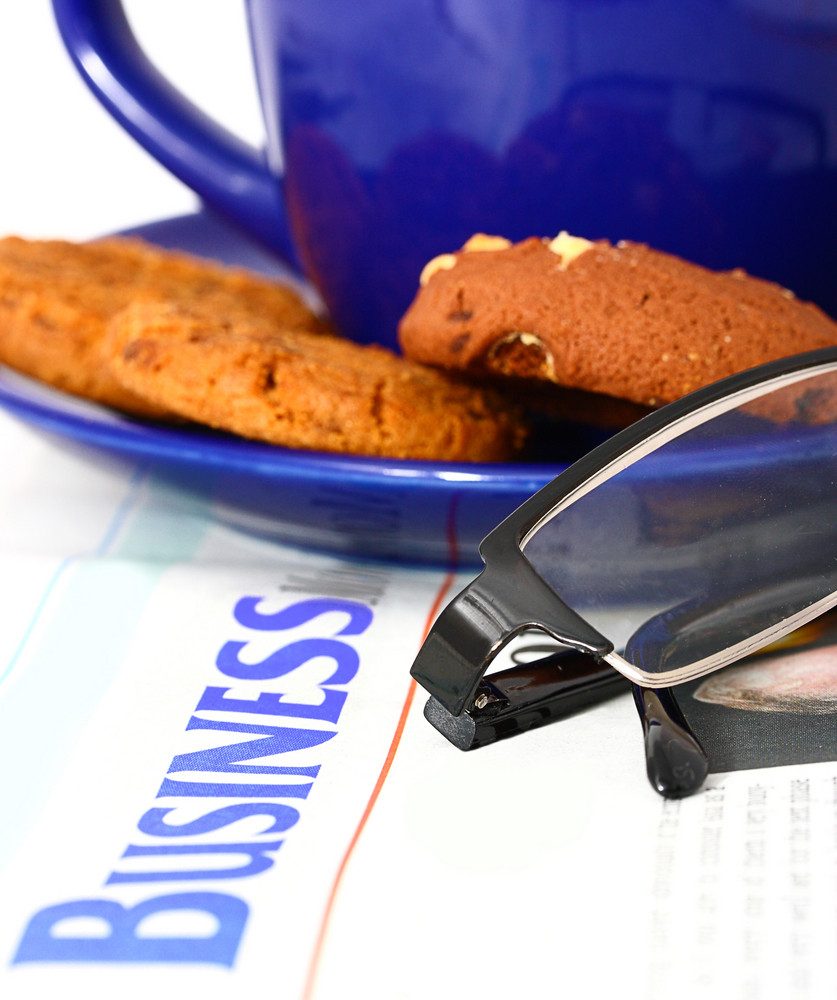 Reading The Business News With A Cup Of Coffee