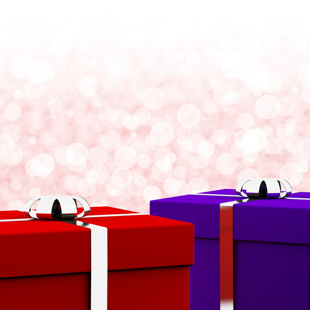 Red And Blue Gift Boxes With Bokeh Background As Presents For Him And Her