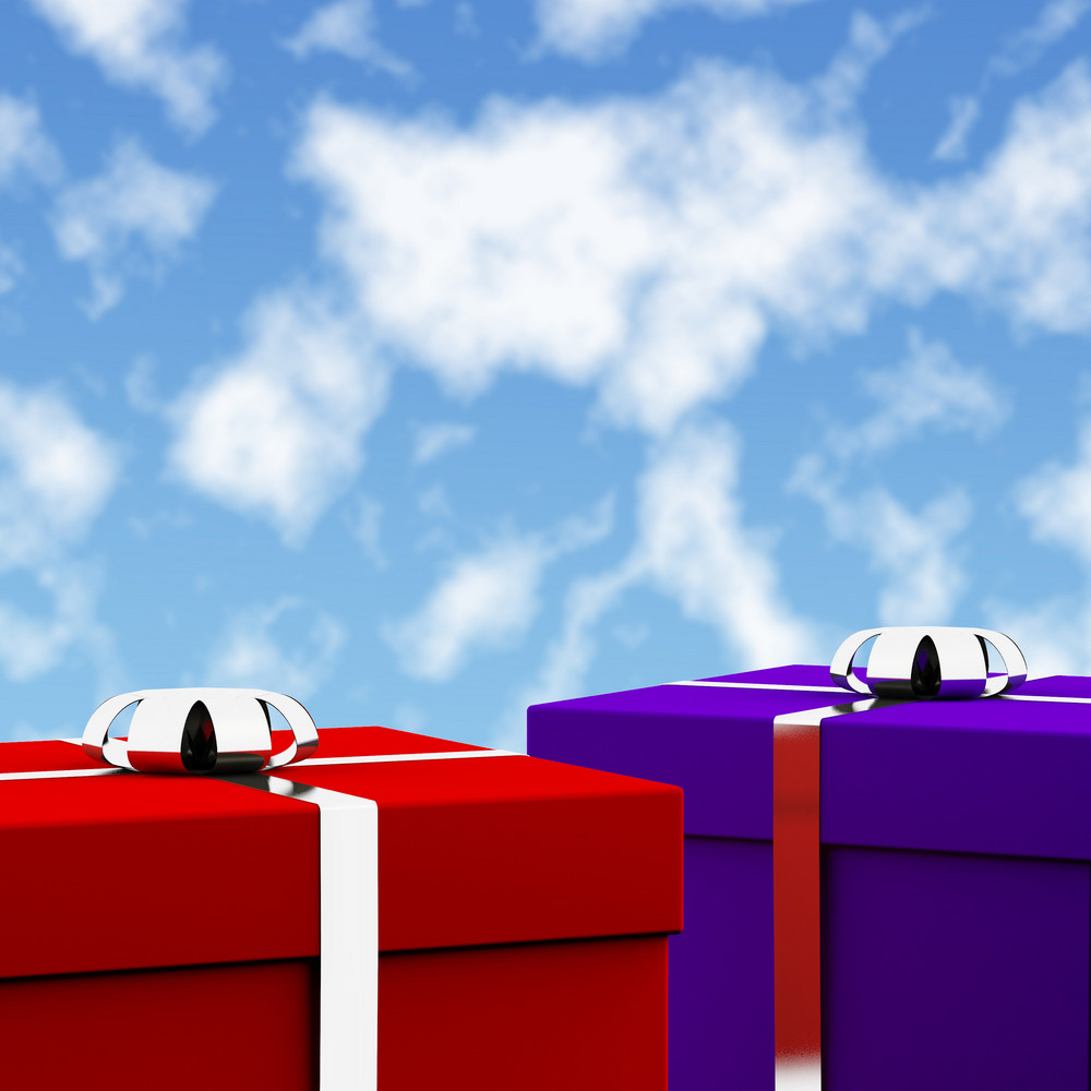 Red And Blue Gift Boxes With Sky Background As Presents For Him And Her