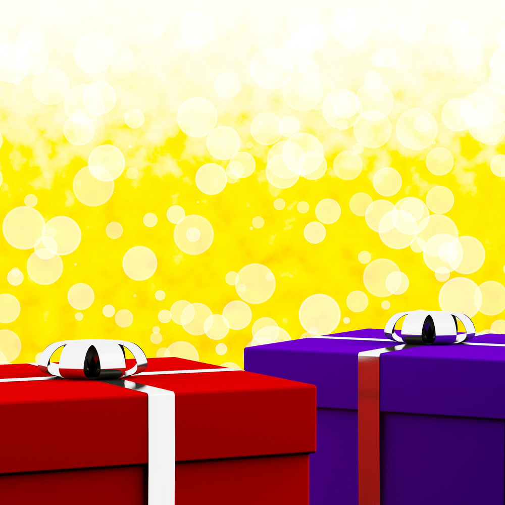 Red And Blue Gift Boxes With Yellow Bokeh Background As Presents For Him And Her