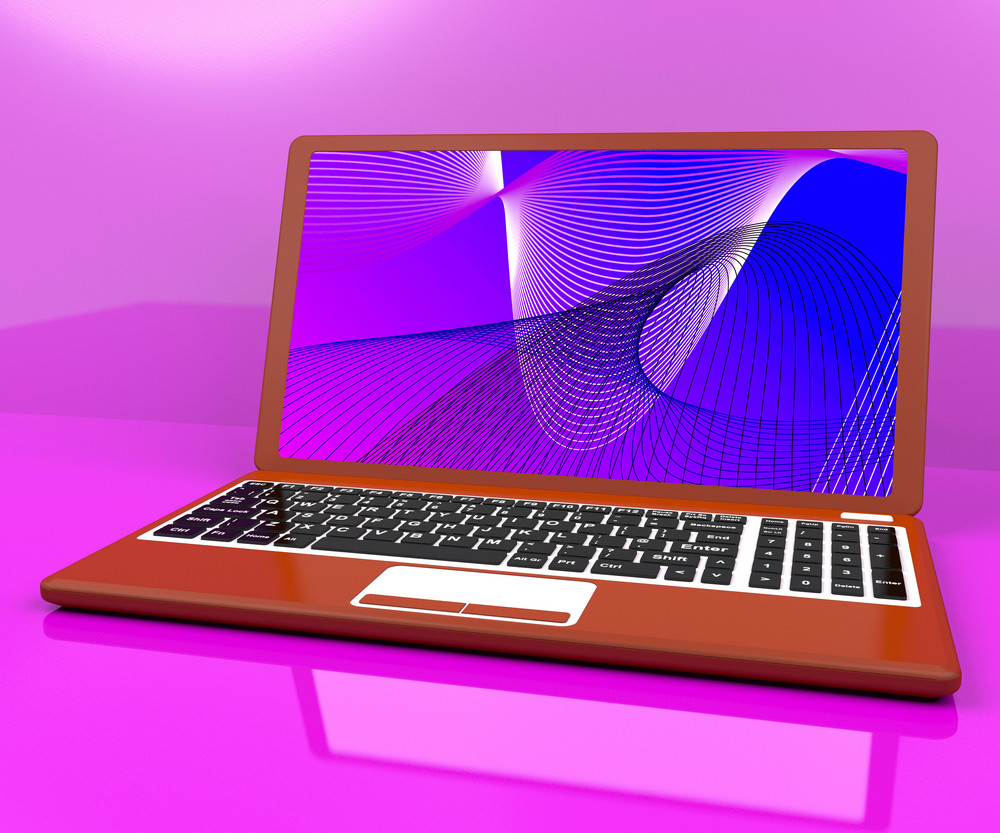 Red Computer On Desk With Spiral Pattern