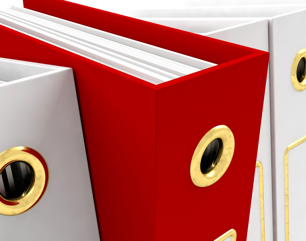 Red File Amongst White Closeup For Getting Office Organized