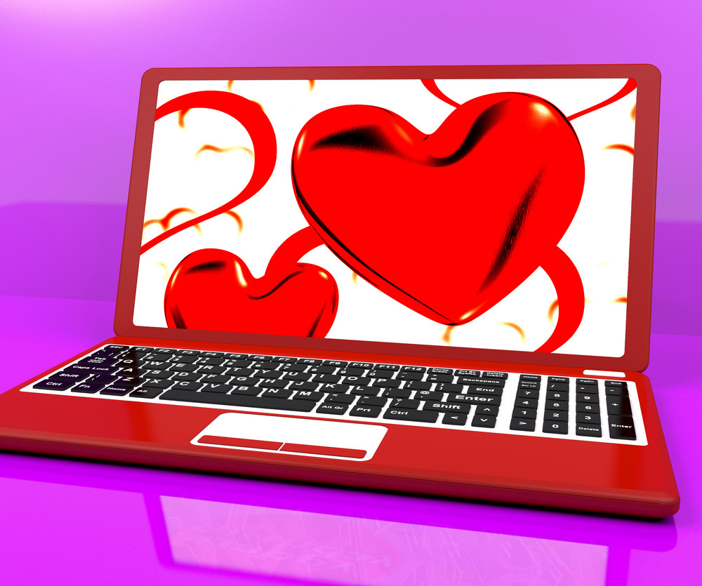 Red Hearts On Laptop Show Love And Romance