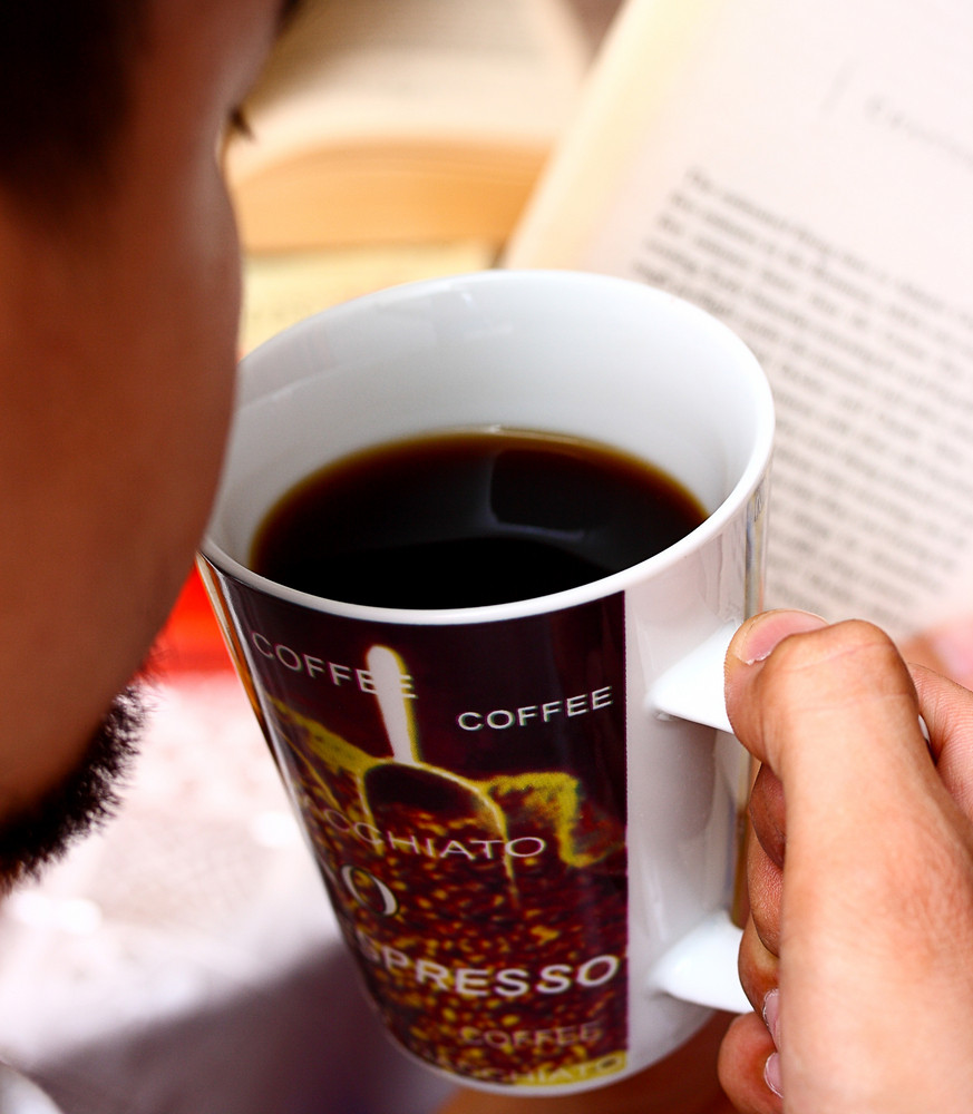 Relaxing By Reading A Novel And Drinking Some Coffee