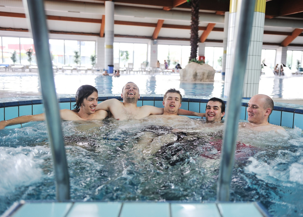 Relaxing in hot tube, jacuzzy, group of young people, friends together