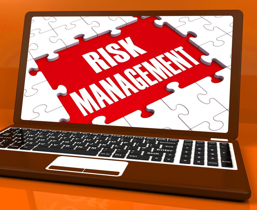 Risk Management On Laptop Showing Risky Analysis