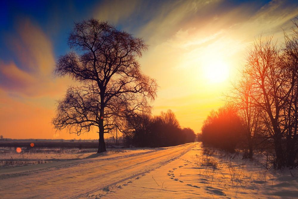 Rural winter landscape at sunset