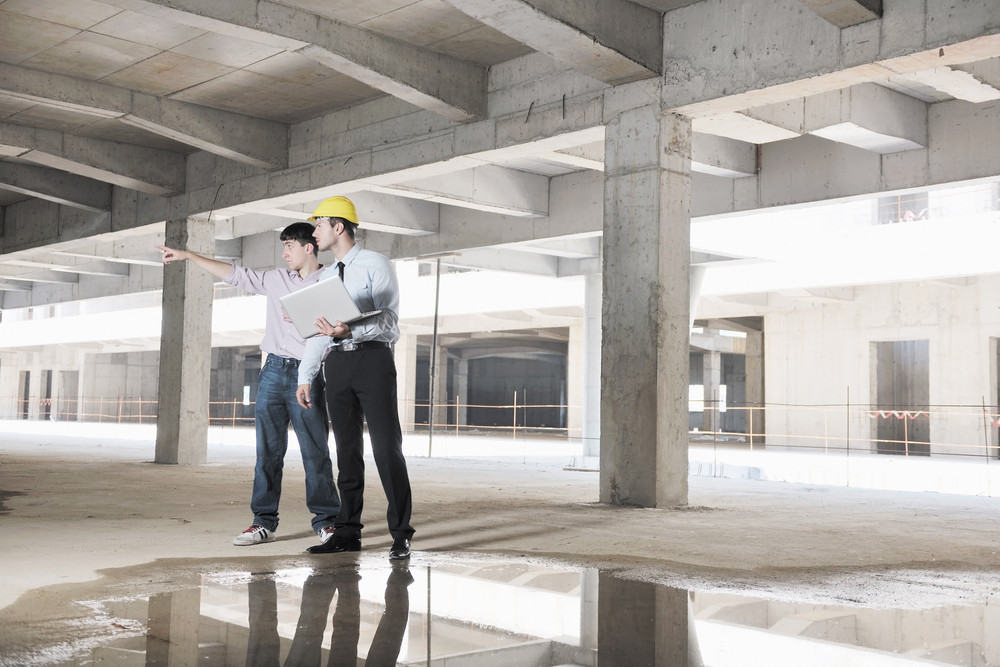 Architect And Engeneer  On Construciton Site Check Documents And Business Workflow On New Building