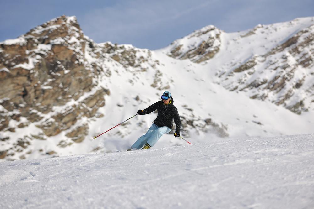 Woman skiing on fresh snow at winter season