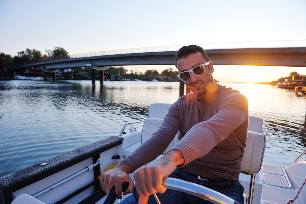 Portrait Of Happy Young Man On Boat