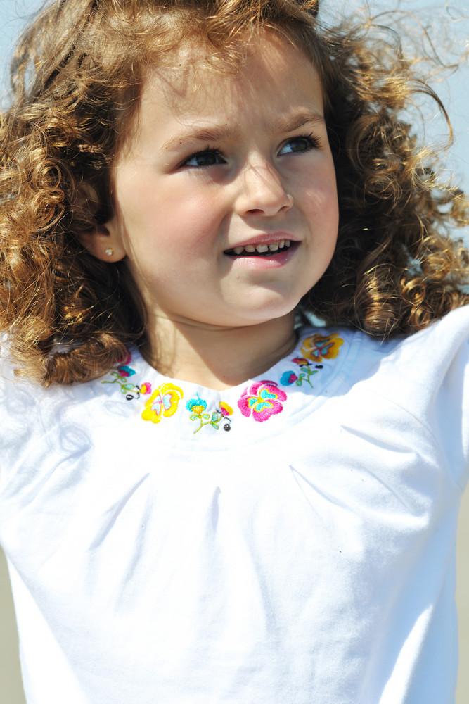 Little Female  Child Portrait On The Beach