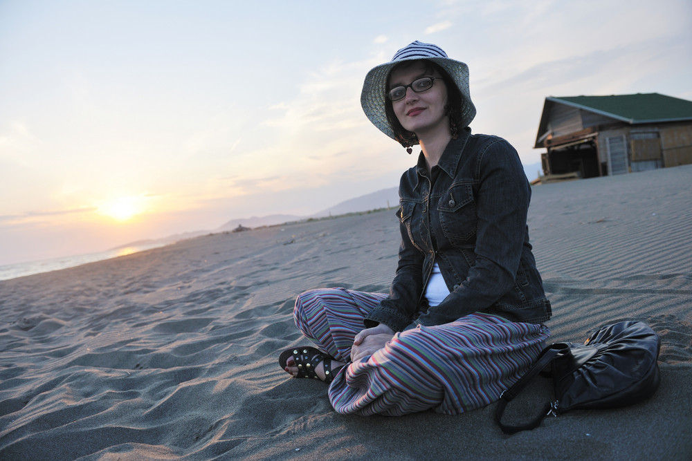 Young Woman Enjoy On Beach