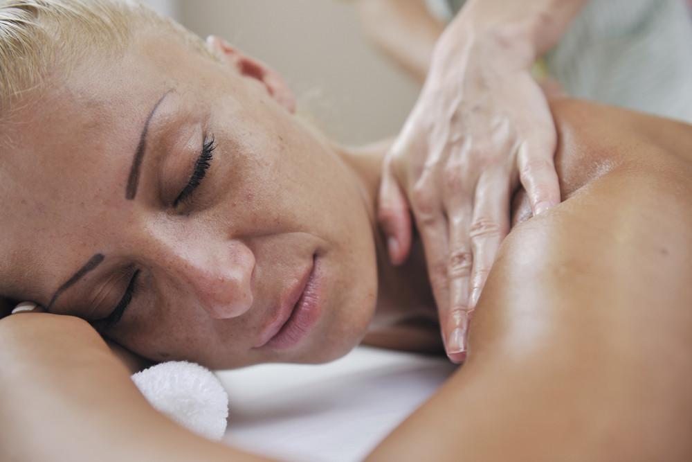 Woman back massage treatment