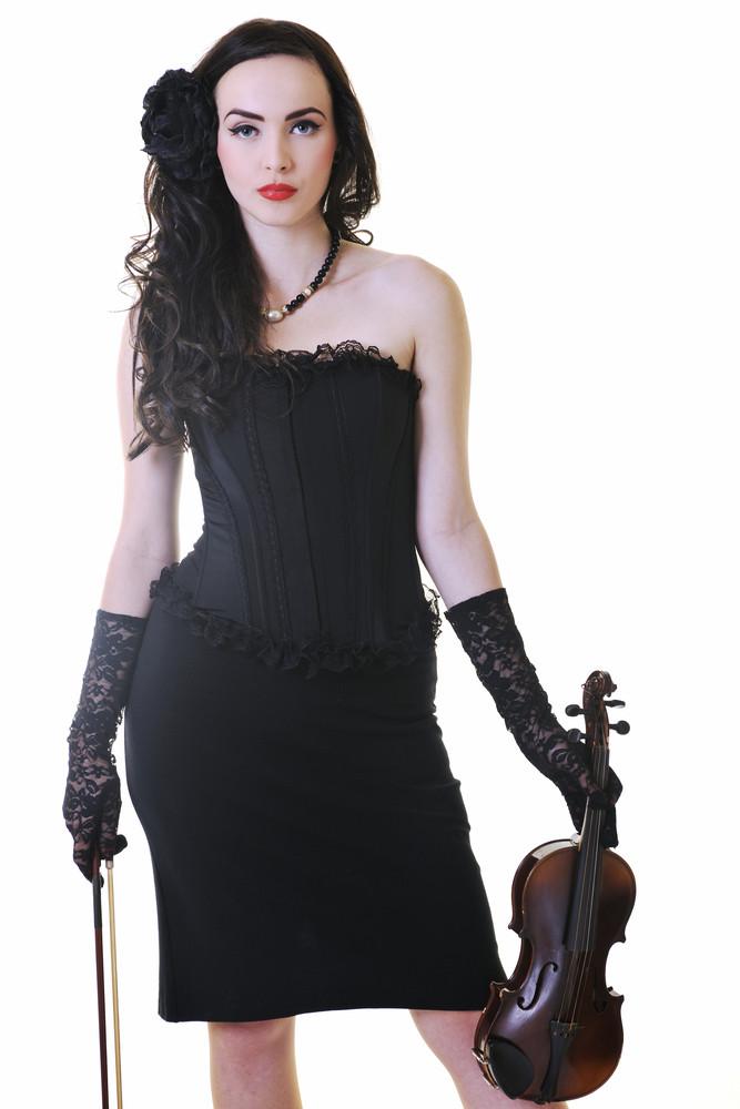 Beautiful young lady play violin