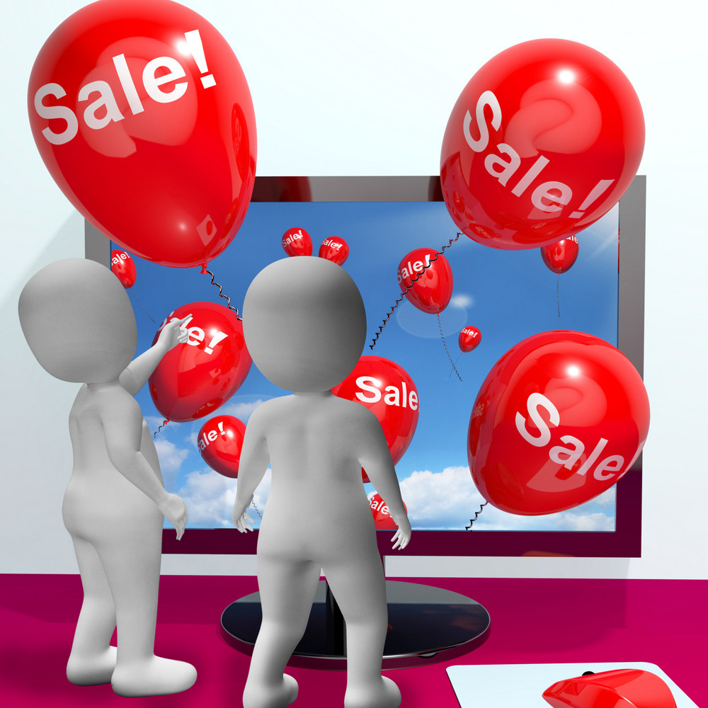 Sale Balloons Coming From Computer Showing Internet Promotion And Reductions