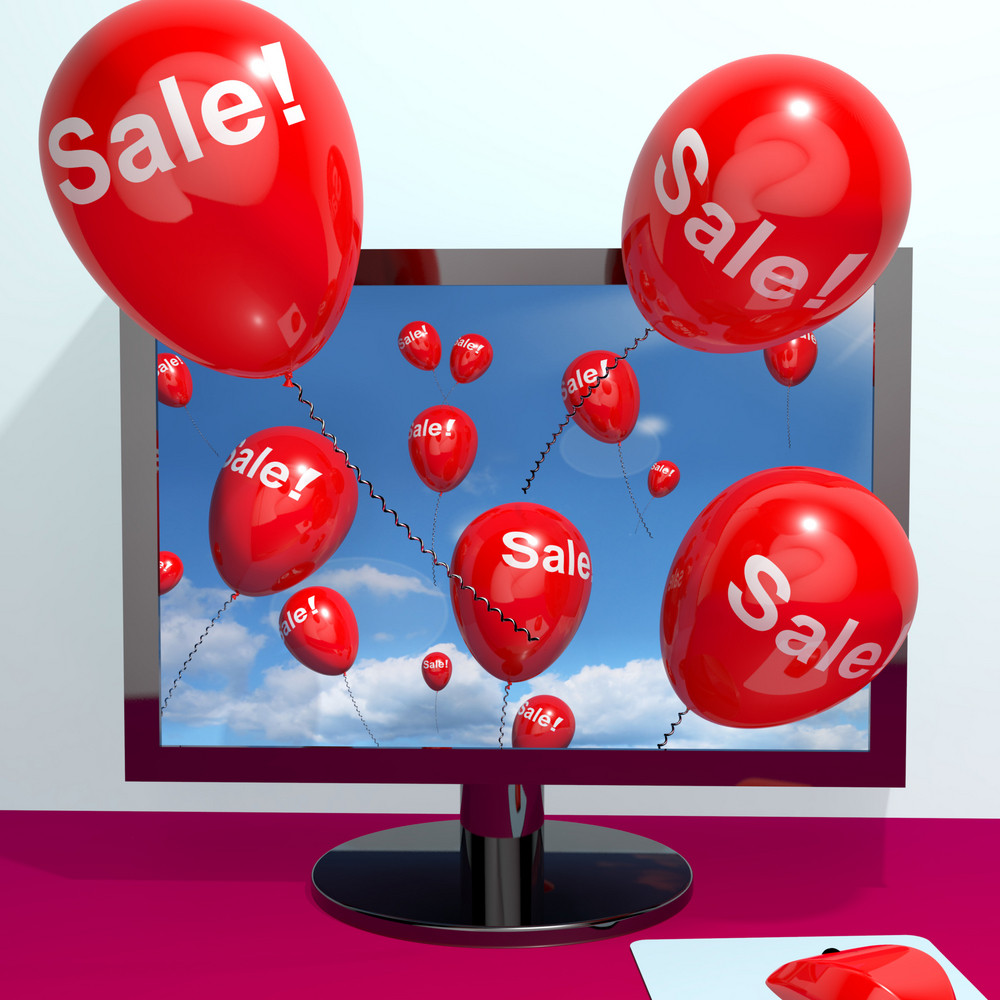 Sale Balloons Coming From Computer Showing Internet Promotion Discount And Reductions