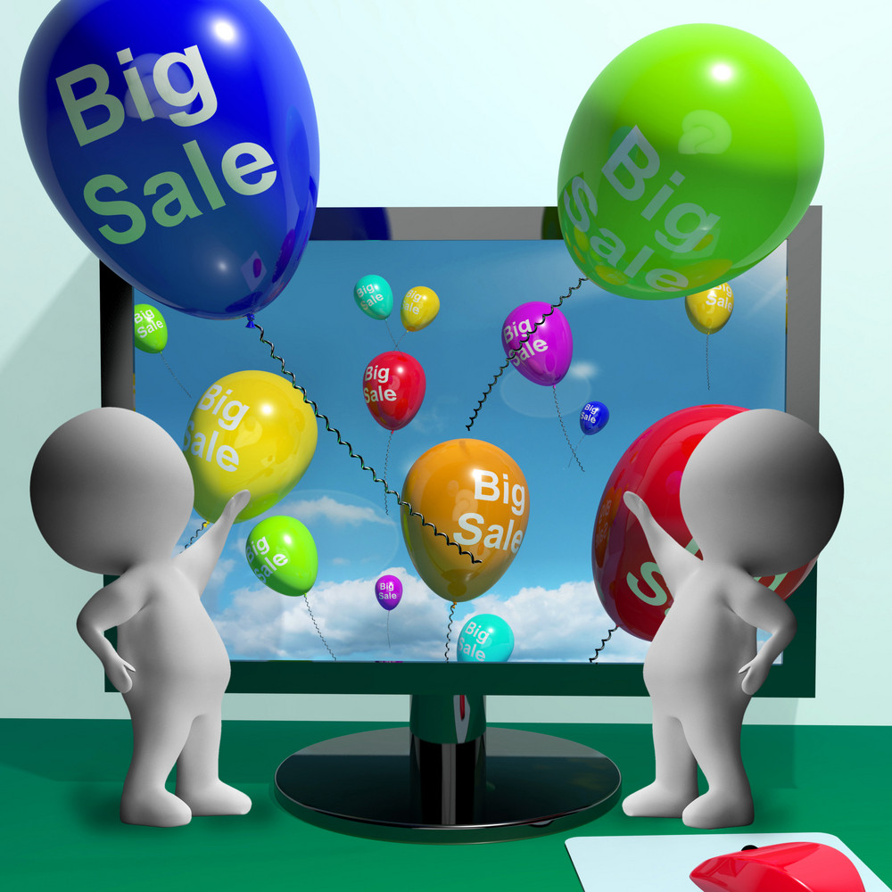 Sale Balloons Coming From Computer Showing Promotion And Reductions Online