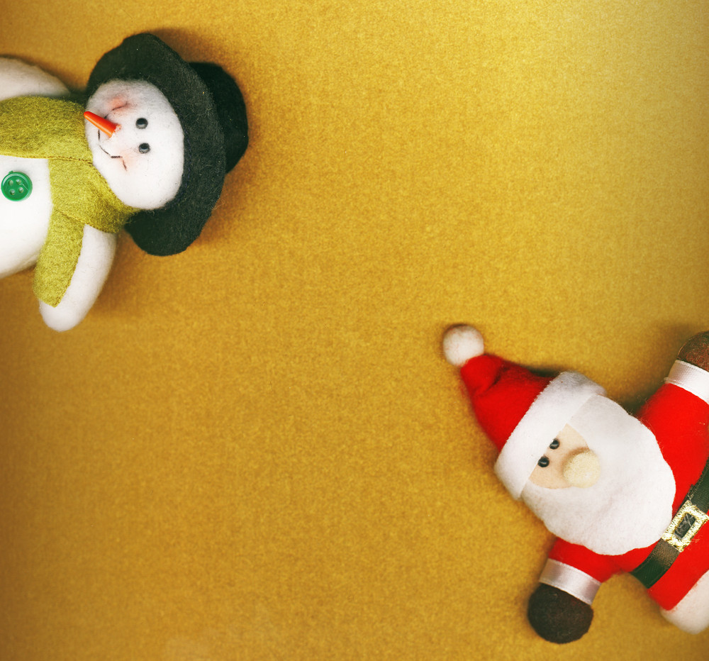Santa Claus And Snowman On The Golden Christmas Background