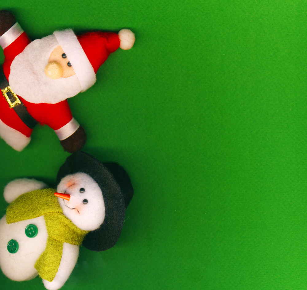 Santa Claus And Snowman On The Green Background