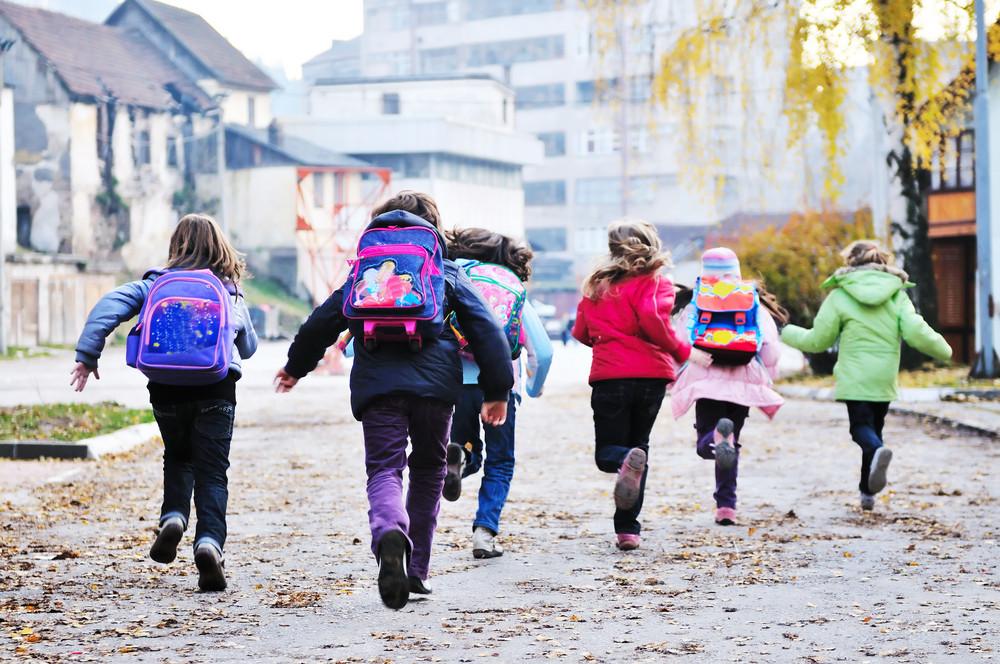 School girls running away
