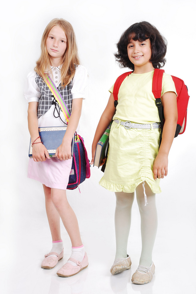School children with bags and books