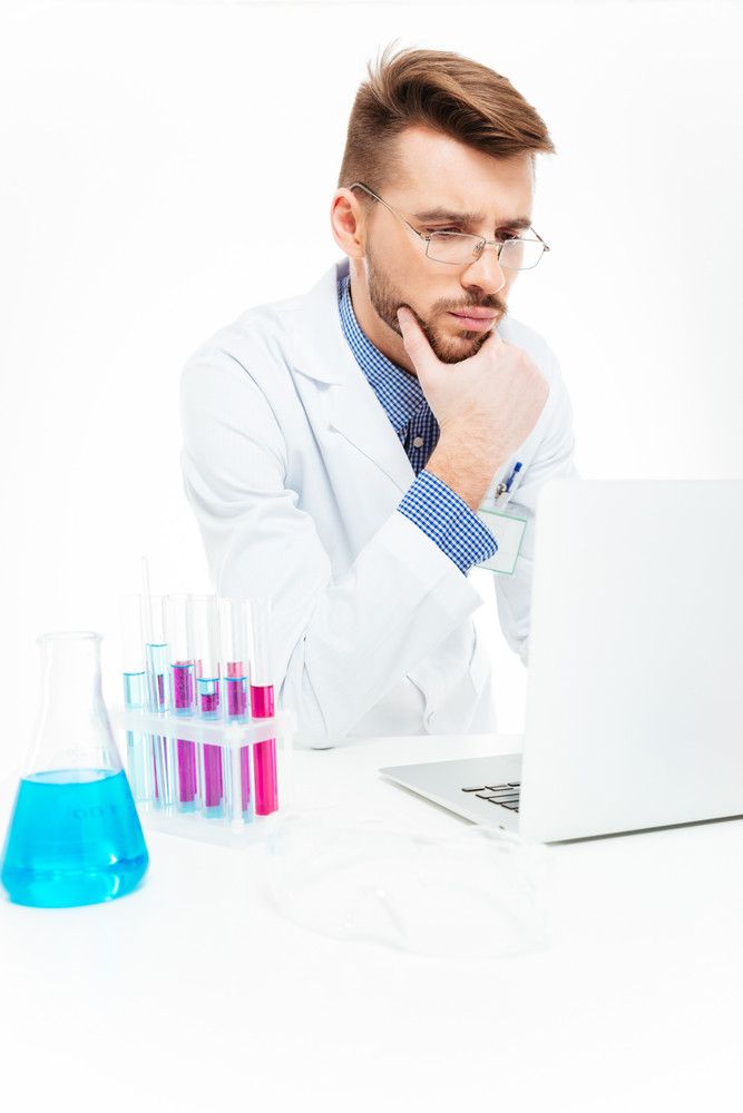 Scientist using laptop computer in laboratory
