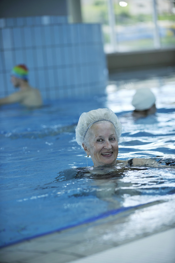 Senior woman at swimming pool