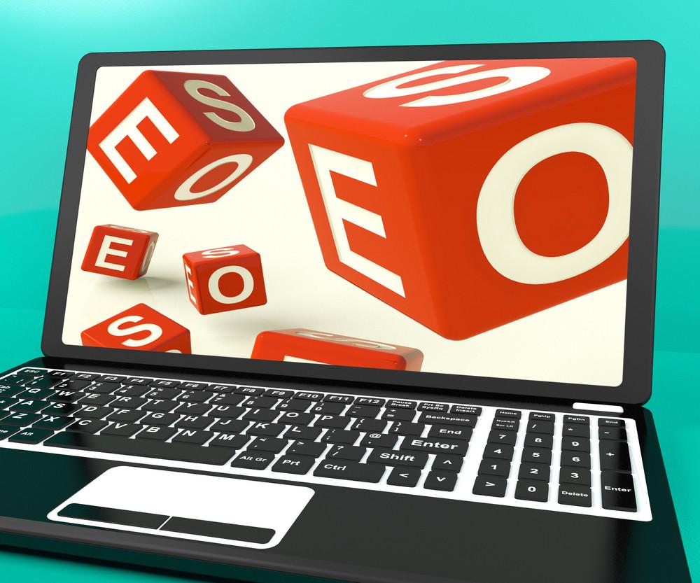 Seo Dice On Laptop Showing Online Web Optimization