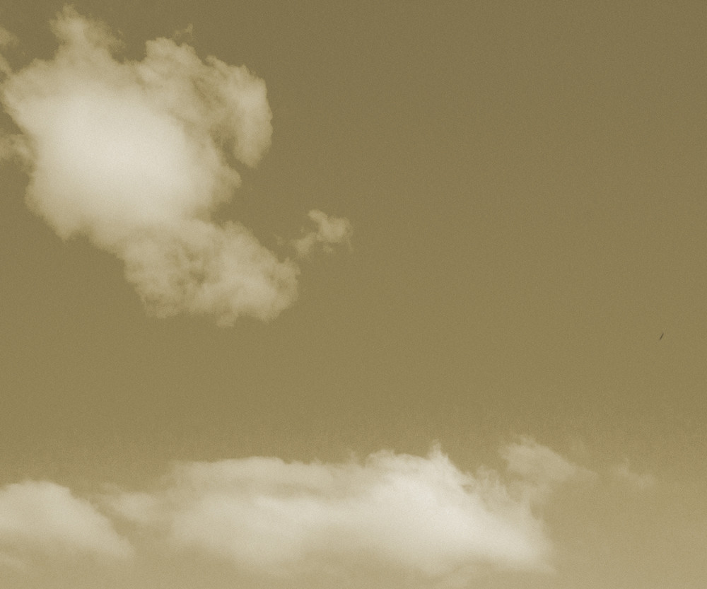 Sepia Clouds On Sky Backdrop