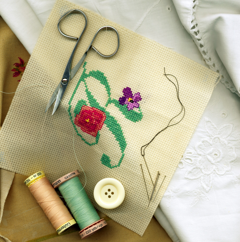 Sewing Needle With Bobbins Of Cotton Thread And Needlework
