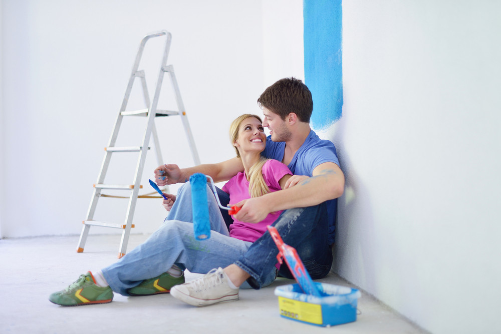 Happy Young Cople Relaxing After Painting In New Home