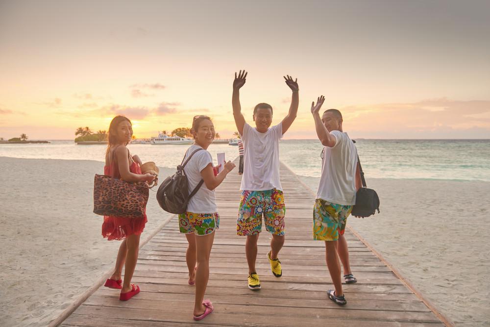 Group of friends on beautiful beach