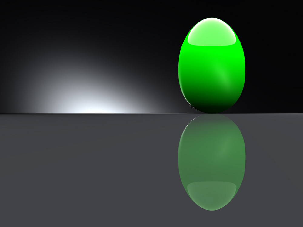 Shiny Green Egg On Black Background.