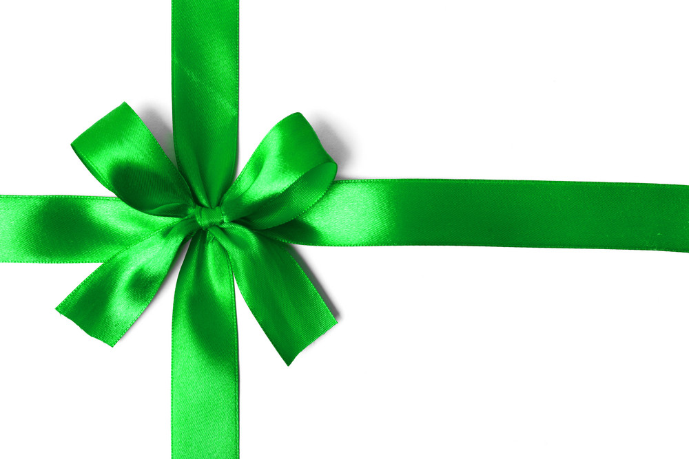Shiny green ribbon on white background