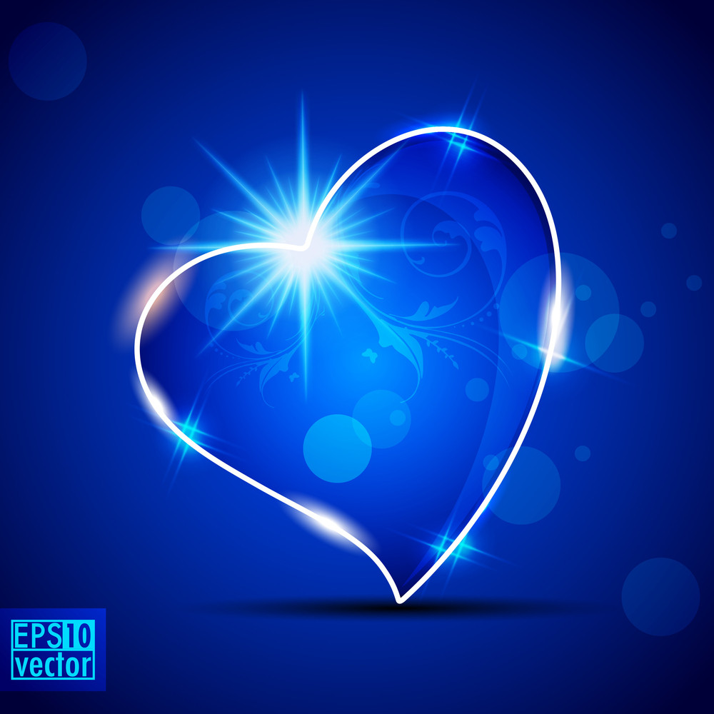 Shiny Heart On Abstract Blue Background.