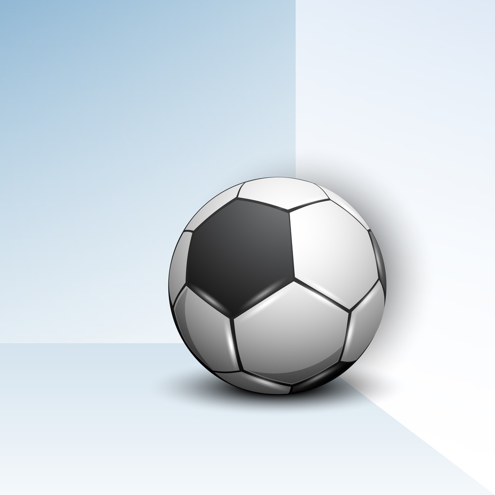 Shiny Soccer Ball Against Blue Wall.