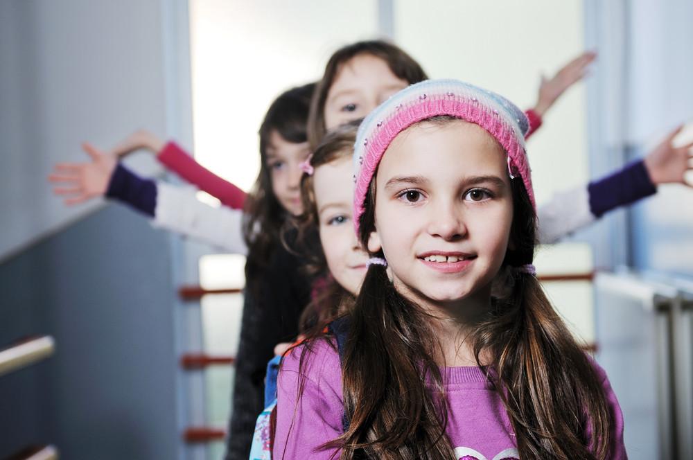 Happy children group in school