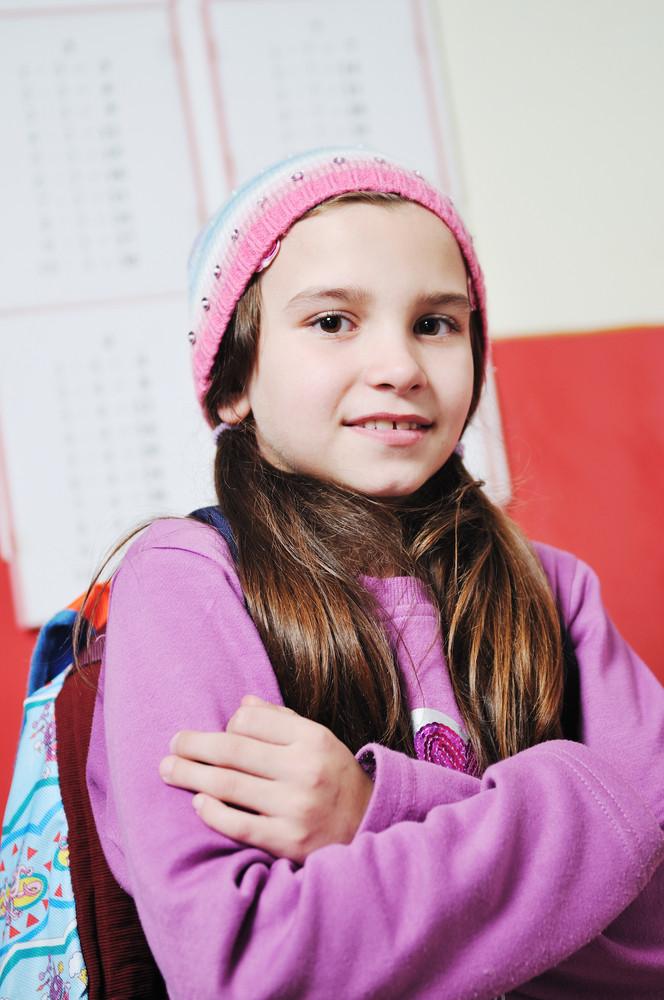 Happy young school girl portrait