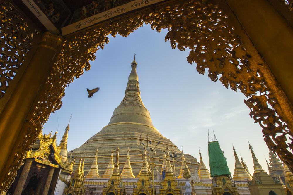 Shwedagon pagoda with blue sky. Yangon. Myanmar or Burma.